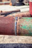 Svarnoy longitudinal welded in Trub, Trub of construction site. A Royalty Free Stock Image