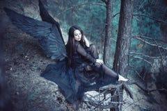 Svart ängel i skogen Royaltyfria Foton