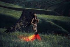 Svart ängel Nätt flicka-demon arkivbild