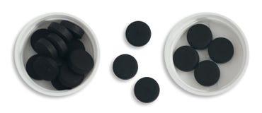 Svart aktiverade kol- och vitChloramphenicolminnestavlor Royaltyfri Foto