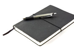 Svart anteckningsbok Arkivbild