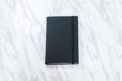 svart anteckningsbok Fotografering för Bildbyråer