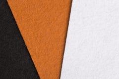 Svart-, apelsin- och vitfilttextur för bakgrund Arkivbild