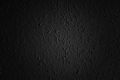 Svart asfaltyttersida Closeup av mörk grungetextur med korn Arkivbild