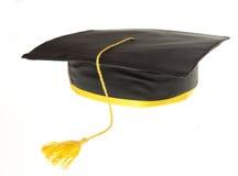 svart avläggande av examenhattdeltagare royaltyfri bild