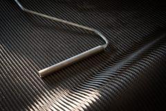 Svart bakgrund för sammansatt material för kolfiber Fotografering för Bildbyråer