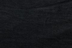 Svart bakgrund, grov bomullstvilljeansbakgrund Jeans texturerar, tyg Arkivfoto