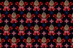 Svart bakgrund med blåa snöflingor som täckas med röda klockor Arkivfoton