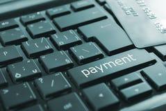 Svart betalningknapp Arkivbild