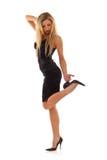 svart blond klänning little som poserar Royaltyfri Bild