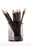 Svart blyertspennahållare med blyertspennor Arkivbilder