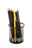 Svart blyertspennahållare med blyertspennor som isoleras på vit Arkivfoto
