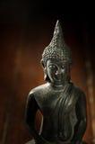 Svart Buddhastaty för stilleben fotografering för bildbyråer