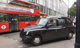 svart cab london Fotografering för Bildbyråer