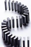 Svart domino i en ro arkivbilder