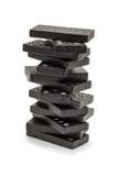 svart domino staplat torn Fotografering för Bildbyråer