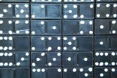 Svart dominobrickabakgrund Royaltyfri Fotografi