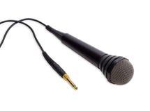 Svart dynamisk mikrofon på en ljus bakgrund Royaltyfri Foto