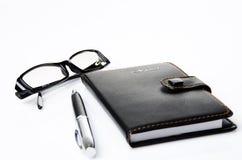 svart exponeringsglasanteckningsbok Royaltyfri Foto