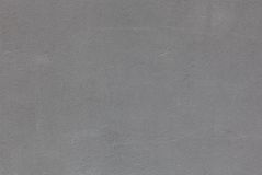 Svart för bakgrundsstengrå färger skrapar texturväggen Arkivbild