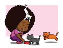 Svart flicka som matar tre katter Fotografering för Bildbyråer