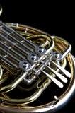svart fransk horn för bakgrund arkivfoto
