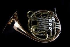 svart fransk horn för bakgrund Arkivbilder