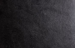 Svart glänsande lädertexturbakgrund fotografering för bildbyråer
