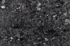 Svart granit vaggar textur royaltyfria foton