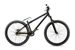 Svart guld- cykel för slopestylesmutshopp Fotografering för Bildbyråer