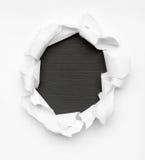 Svart hål i vitt papper Royaltyfria Bilder