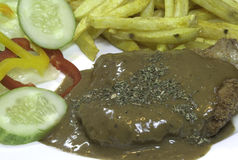 svart höna stekt pepparsås Royaltyfri Bild