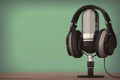 Svart hörlurar över mikrofonen framförande 3d Arkivbild