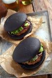 Svart hamburgare Royaltyfria Bilder