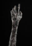 Svart hand av död, gå absolut, levande dödtema, halloween tema, levande dödhänder, svart bakgrund, mammahänder Royaltyfri Fotografi