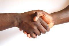 svart handskakning Arkivfoto