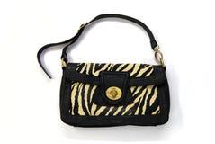 svart handväskatappning Arkivbild
