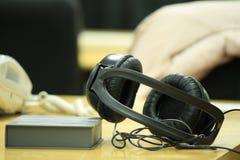 svart headphone Fotografering för Bildbyråer