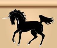 svart heraldisk unicorn Arkivfoto