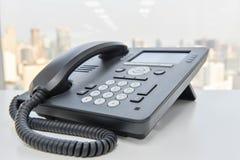 Svart IP-telefon för affärskommunikation Arkivbilder
