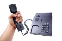 Svart isolerad kontorstelefon Arkivfoton