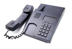 Svart isolerad kontorstelefon Arkivbilder