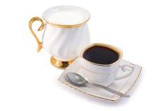 Svart kaffe och mjölkar Fotografering för Bildbyråer