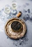 Svart kaviar på is och champagne Fotografering för Bildbyråer