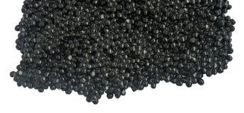 Svart kaviar som isoleras på vit bakgrund arkivfoton