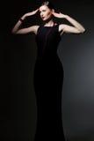 svart klänningkvinnabarn arkivbilder