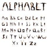 Svart klätt folk som bildar alfabetfolk arkivbild