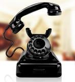 Svart klassisk telefon på ett hem Arkivfoto