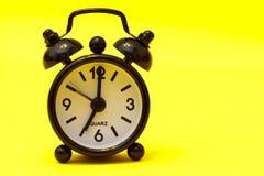 svart klocka för alarm Royaltyfria Bilder
