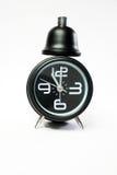 svart klocka för alarm Fotografering för Bildbyråer